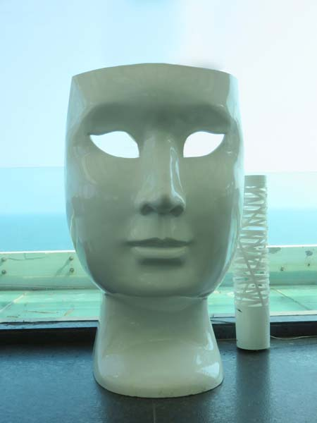theatre face statue at a top floor restaurant at the Visakhapatman India hotel overlooking the Bay of Bengal, copyright 2015Janet Kuypers