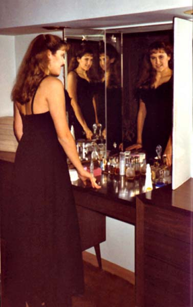 Janet in mirror, copyright 1990-2016 Janet Kuypers