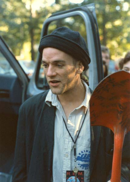 Michael Stipe with a shovel