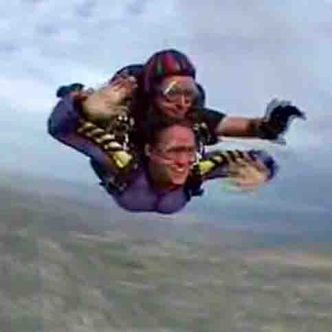video still of Janet jumping out of an airplane