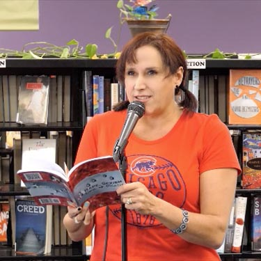 "Janet with the book &#8220Rape, Sexism, Life & Death"" at Recycled Reads 10/21/17"