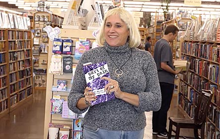 "Janet with the book ""Part of my Pain"" at Half Price Books 11/1/17"